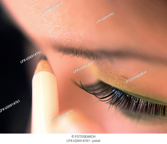 A Woman Penciling Eyebrow, High Angle View, Differential Focus