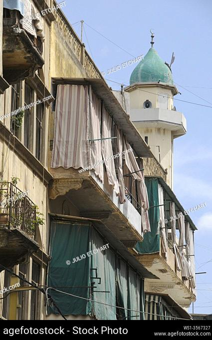BALCONIES AND MOSQUE IN WEST BEIRUT, LEBANON.