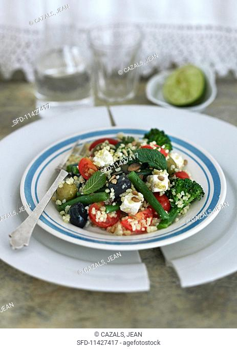 Greek salad with green beans, broccoli, tomatoes, bulgur and olives