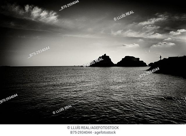 Silhouette of fisherman. Sa Mesquida beach, Minorca, Balearic Islands, Spain