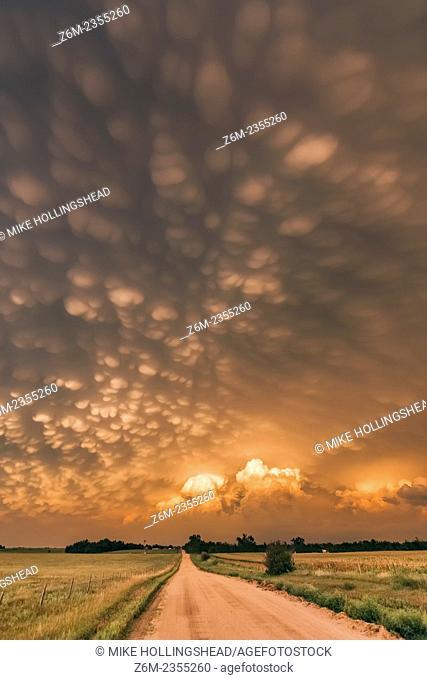 Intense mammatus form over eastern Nebraska behind a line of storms