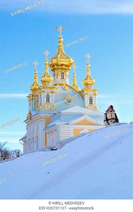 young women near beautiful church in winer. Petergof, St. Petersburg, Russia