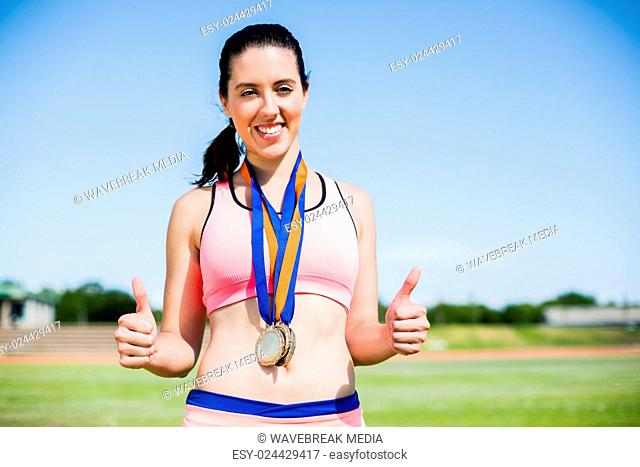 Female athlete with gold medals around her neck