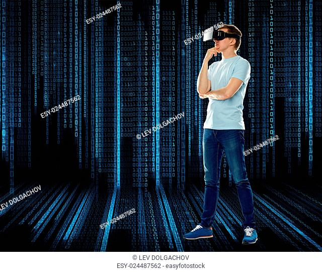 3d technology, virtual reality, entertainment, cyberspace and people concept - happy young man with virtual reality headset or 3d glasses thinking over black...