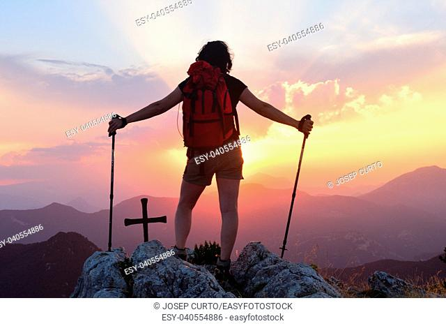 Hiker woman watching the sunset