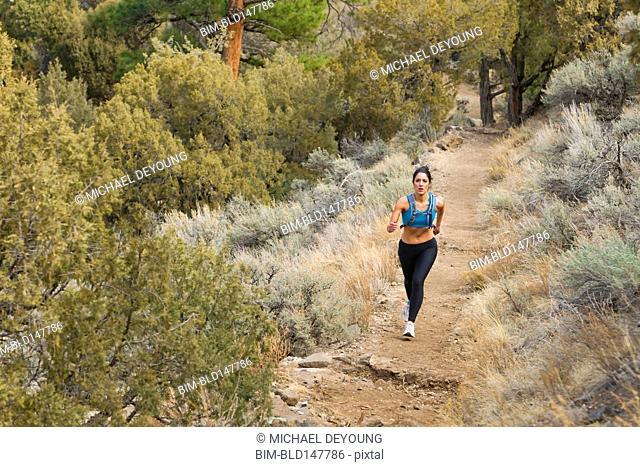 Hispanic runner training in remote area