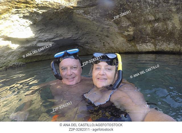 Couple snorkeling at Italian coast