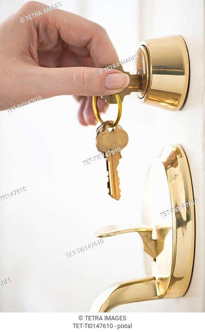 Woman opening door lock