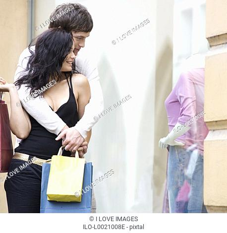 A young couple out shopping