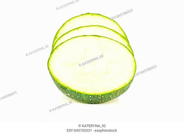 Three slices of round zucchini isolated on white background fresh summer squash