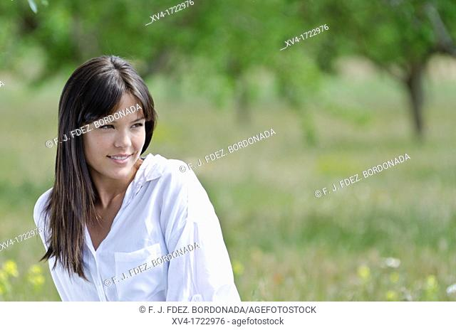 Brunette breathing fresh air in the ruralscape
