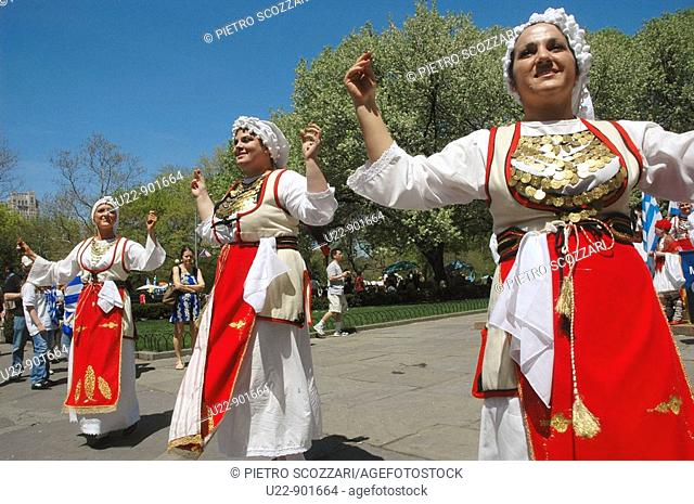 New York City (USA): Greek-American women dancing sirtaki at Grand Army Plaza, in front of the Plaza Hotel, before the Greek Parade