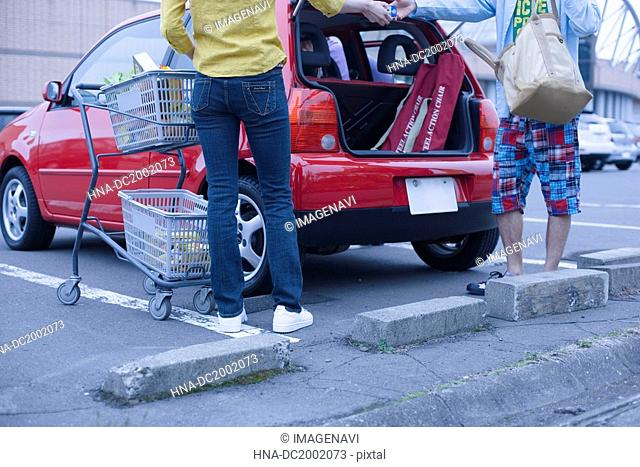 Couple Loading Groceries into a Car