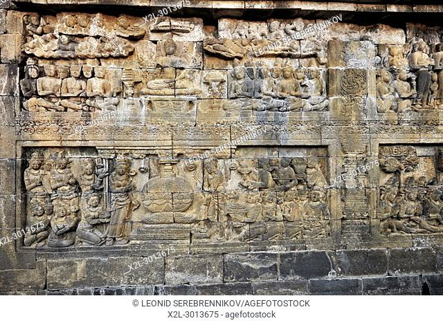 Reliefs on a corridor wall. Borobudur Buddhist Temple, Magelang Regency, Java, Indonesia