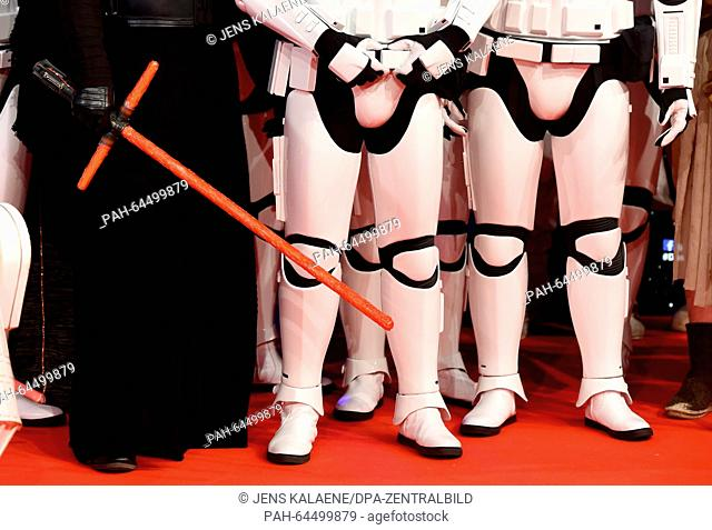 Dressed up fans in Star Wars costumes pose on the red carpet at the Zoo Palast in Berlin, Germany, 16 December 2015. This evening the premiere of the new...