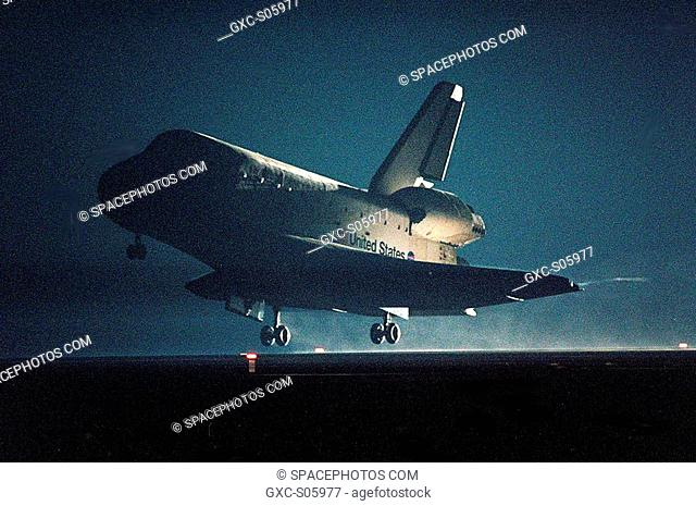 05/29/2000 -- The landing lights on Runway 15 cast a glow as Space Shuttle Atlantis approaches touchdown on KSC's Shuttle Landing Facility to complete the 9-day