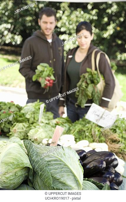 Multi-ethnic couple looking at vegetables