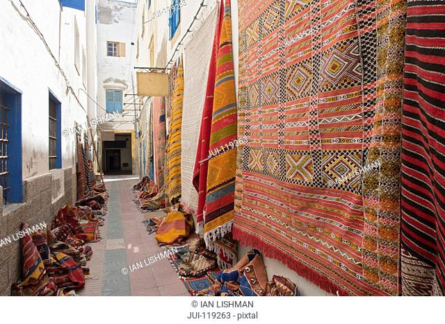 Traditional carpets for sale outside carpet shop, Essaouira, Morroco