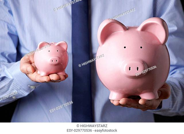 Man Holding Small Piggy Bank Stock Photos And Images Age