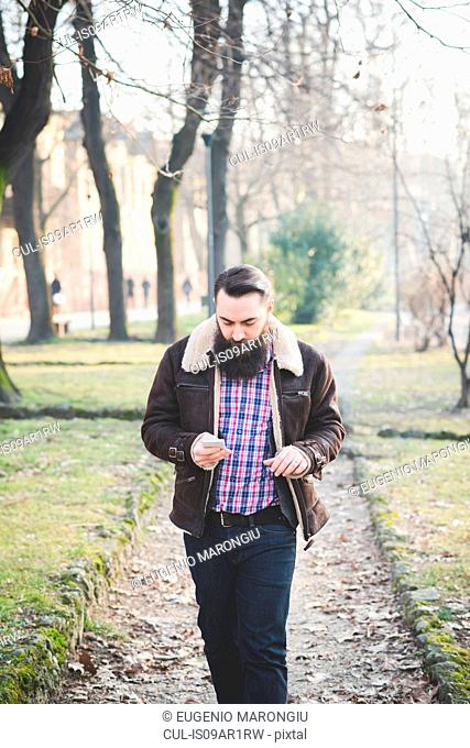 Young bearded man in park