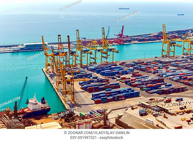 BARCELONA, SPAIN - AUGUST 21, 2012: Terminal Port Nou, Industrial Port for freight transport ship in import export and business logistic, By crane, Trade Port