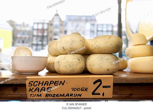 Round cheeses in shop window, Amsterdam, Netherlands