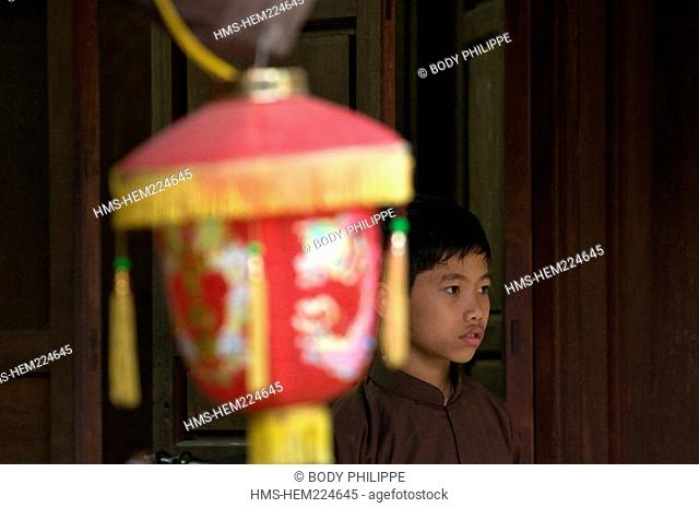 Vietnam, Thai Binh, Keo Pagoda, Chua Keo, built in the twelfth century, a young boy dressed as novice