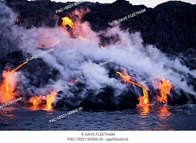 Hawaii, Big Island, Kalapana, Pahoehoe lava flowing from Kilauea reaching the Pacific Ocean