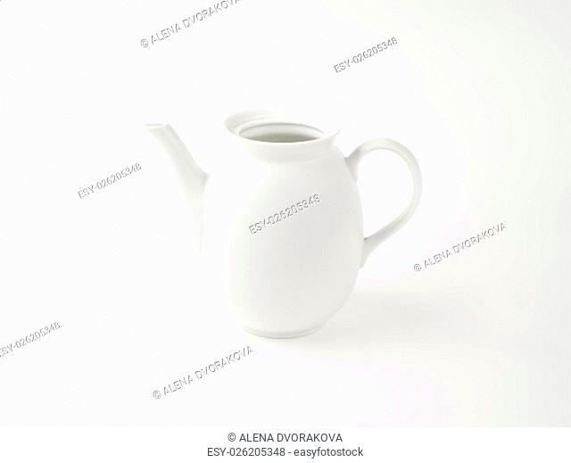 empty white porcelain milk jug