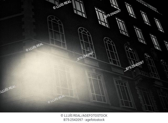 Night view of the windows with the lights of an office building in the City of London, England, UK, Europe