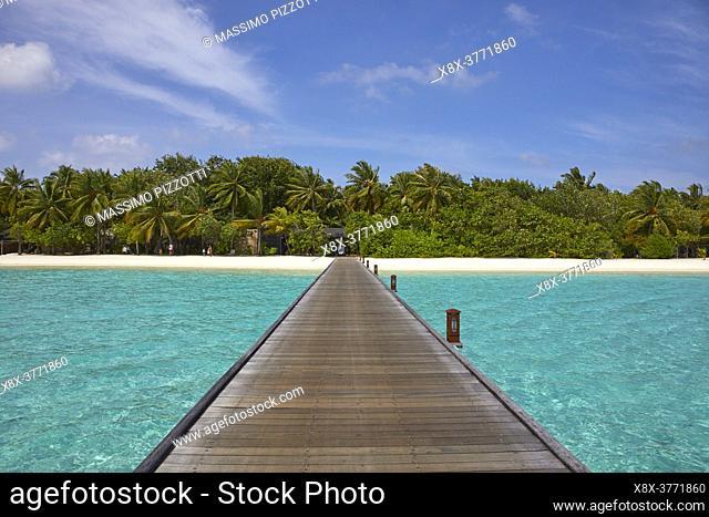 Footbridge of Paradise Island (Lankanfinolhu) at sunset, Maldives