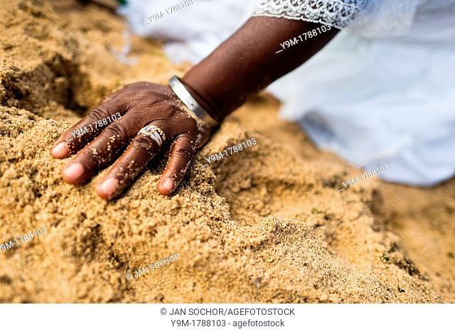 A hand of a Baiana woman in the sand seen during the festival of Yemanjá, the goddess of the sea, in Salvador, Bahia, Brazil, 2 February 2012  Yemanjá