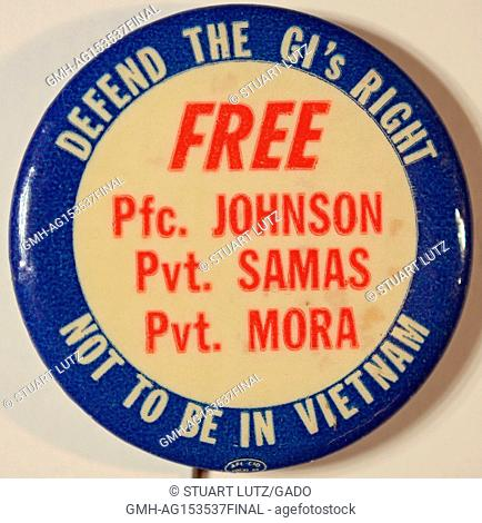 Antiwar pinback button titled Defend the GIs, with a message advocating to free Pfc Johnson, Pfc Samas and Pfc Mora, three servicemen who were jailed during the...