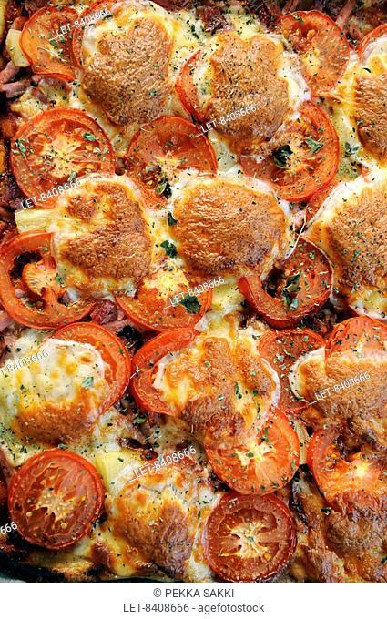 Mozzarella, tomato and basil on a pizza