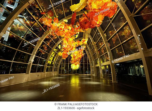 Glass House, with Seattle Space Needle in background.Dale Chihuly Garden and Glass.Seattle,Washington USA