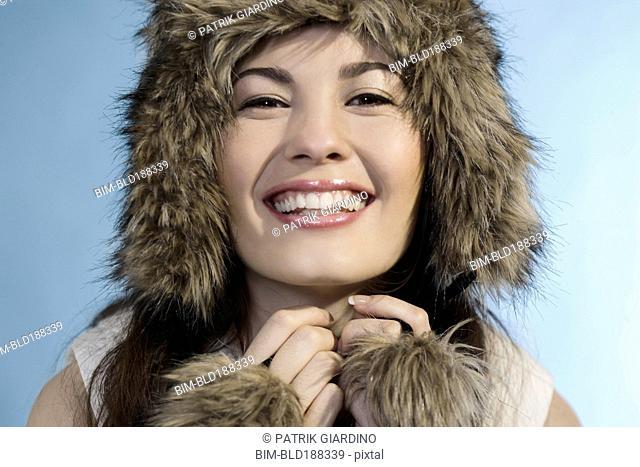 Mixed Race woman wearing fur hat
