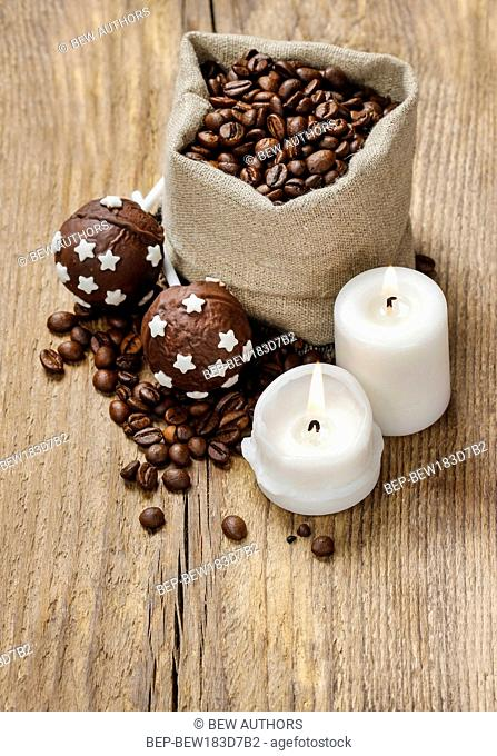 Jute sack of coffee beans on wooden table, copy space