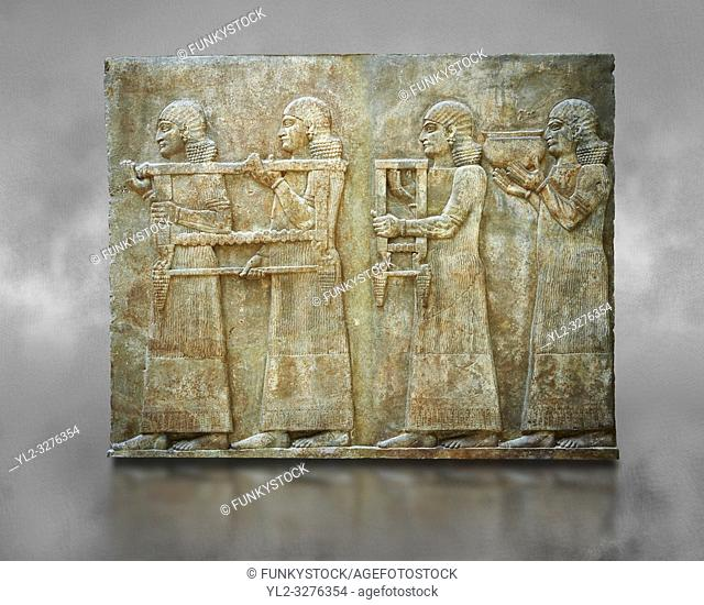 Stone relief sculptured panel of two servants. Facade L. Inv AO 19879 from Dur Sharrukin the palace of Assyrian king Sargon II at Khorsabad, 713-706 BC
