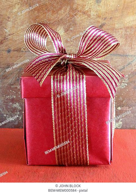 Christmas gift with gold bow