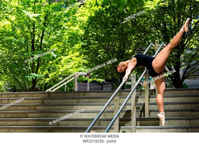 Female ballet dancer dancing on the steps