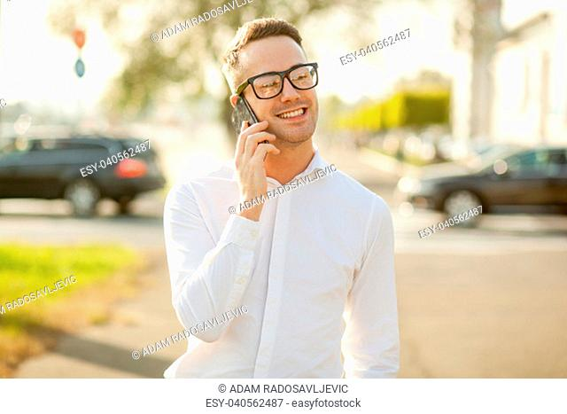 Man with glasses speak on mobile phone, In City, Urban Space, Park