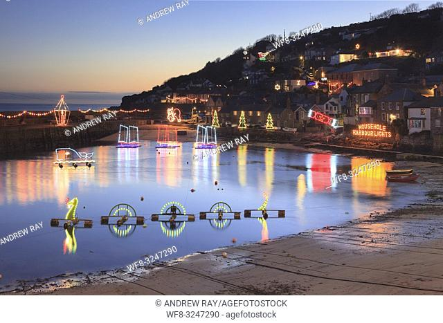 Christmas Lights reflected in Mousehole Harbour on the south coast of Cornwall