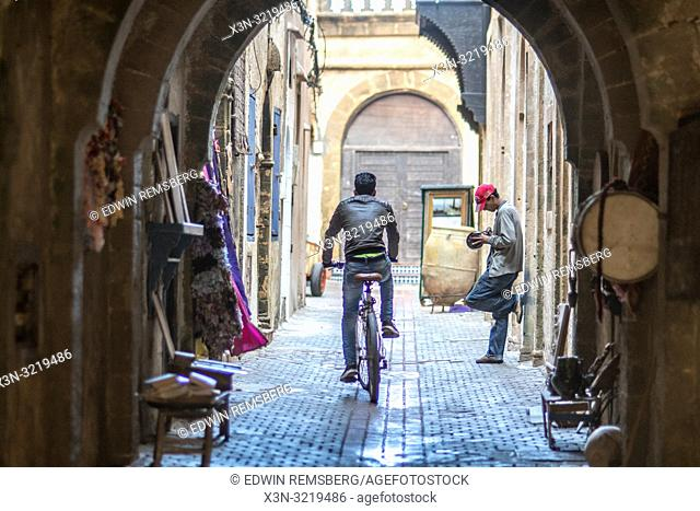 Man Riding a Bicycle Down an Alley, Essaouira, Marrakesh-Safi, Morocco