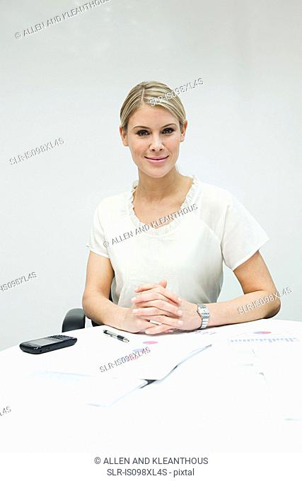 Portrait of businesswoman at table