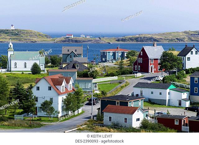 Colourful homes, buildings and churches in an atlantic coast village; Bonavista, Newfoundland and Labrador, Canada