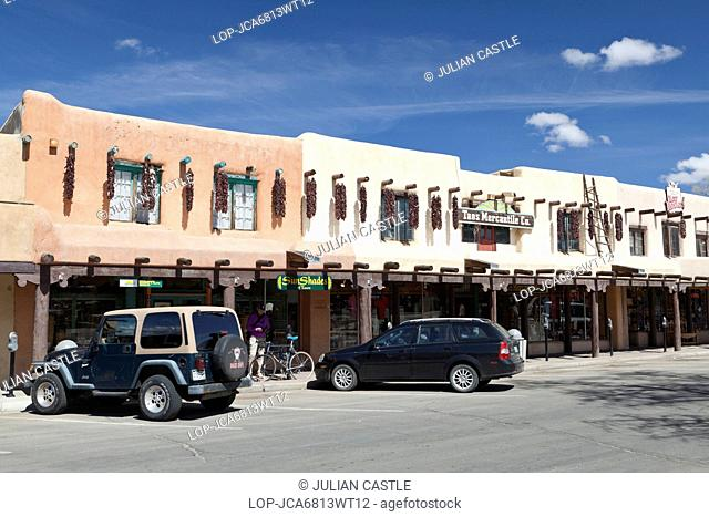 USA, New Mexico, Taos. Adobe store fronts in the town plaza