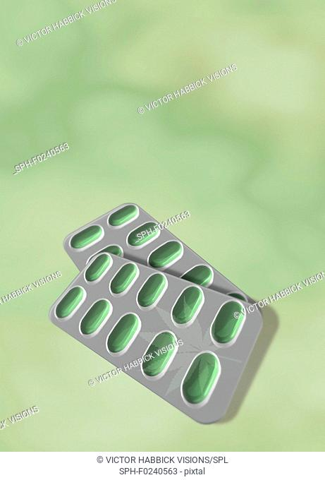 Medical cannabis, conceptual image. Leaf of the cannabis plant (Cannabis sativa) on blisterpacks of pills. Cannabis (also known as marijuana) contains the...