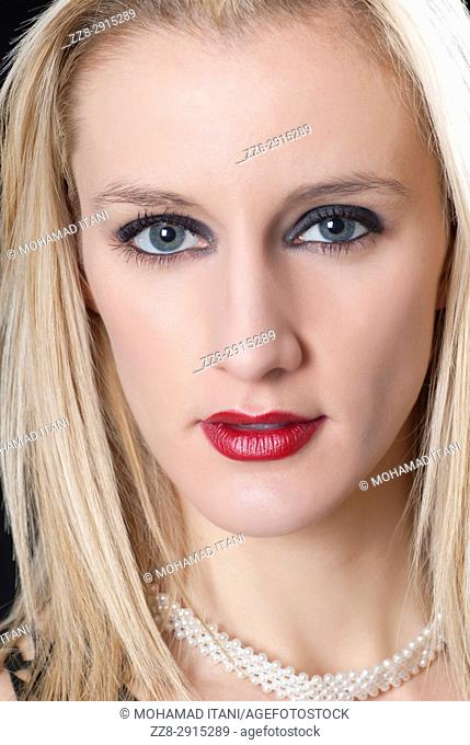 Close up portrait of a beautiful blond woman staring