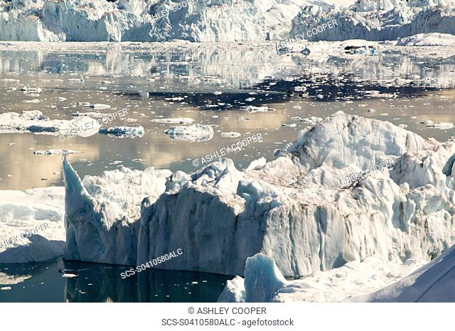 The Jacobshavn glacier or Sermeq Kujalleq drains 7 of the Greenland ice sheet and is the largest glacier outside of Antarctica It calves enough ice in one day...