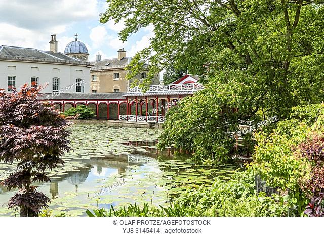 The Chinese Pond and house at Woburn Abbey and Gardens, near Woburn, Bedfordshire, England. It is the seat of the Duke of Bedford and the location of the Woburn...